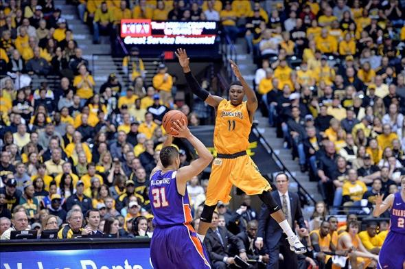 Feb 1, 2014; Wichita, KS, USA; Wichita State Shockers forward Cleanthony Early (11) defends against Evansville Aces guard D.J. Balentine (31) during the first half at Charles Koch Arena. Mandatory Credit: Peter G. Aiken-USA TODAY Sports