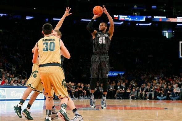 Feb 1, 2014; New York, NY, USA; Georgetown Hoyas guard Jabril Trawick (55) shoots over Michigan State Spartans defense during the first half at Madison Square Garden. Mandatory Credit: Anthony Gruppuso-USA TODAY Sports