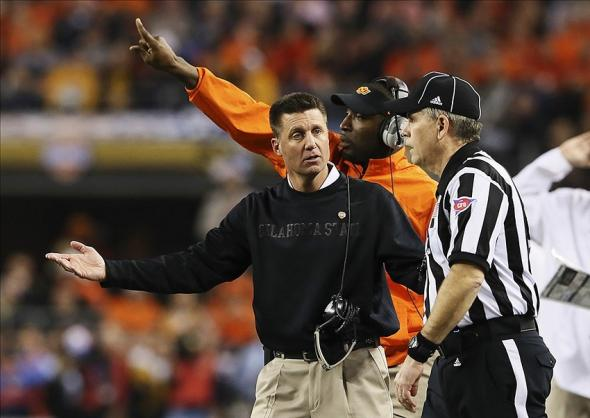 Jan 3, 2014; Arlington, TX, USA; Oklahoma State Cowboys head coach Mike Gundy argues with an official during the first half against the Missouri Tigers in the 2014 Cotton Bowl at AT&T Stadium. Mandatory Credit: Kevin Jairaj-USA TODAY Sports