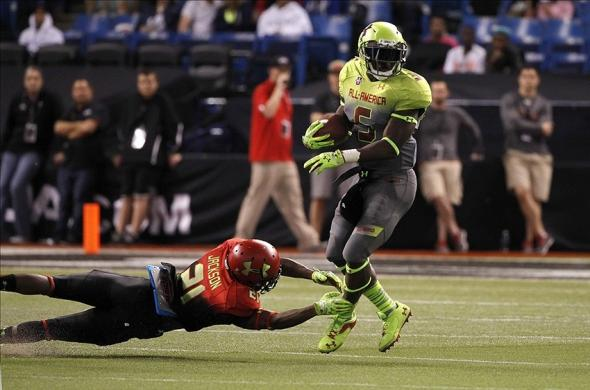 Jan 2, 2014; St. Petersburg, FL, USA; Team Nitro cornerback Jabrill Peppers (5) runs with the ball as Team Hightlight cornerback Adoree Jackson (21) defends during the second half at Tropicana Field. Team Highlight defeated the Team Nitro 31-21. Mandatory Credit: Kim Klement-USA TODAY Sports