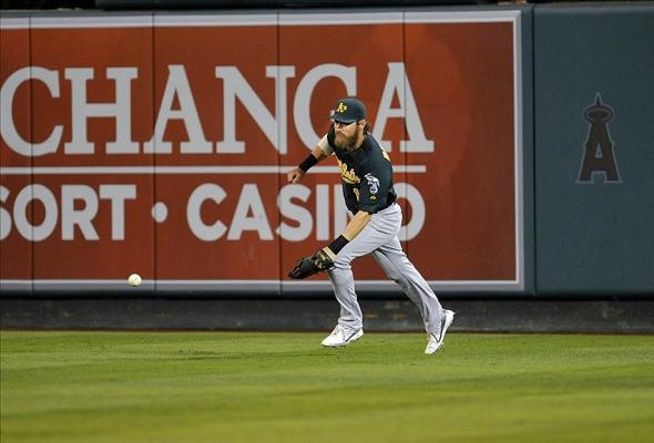 September 23, 2013; Anaheim, CA, USA; Oakland Athletics right fielder Josh Reddick (16) runs to field a hit in the sixth inning against the Los Angeles Angels at Angel Stadium of Anaheim. Mandatory Credit: Gary A. Vasquez-USA TODAY Sports