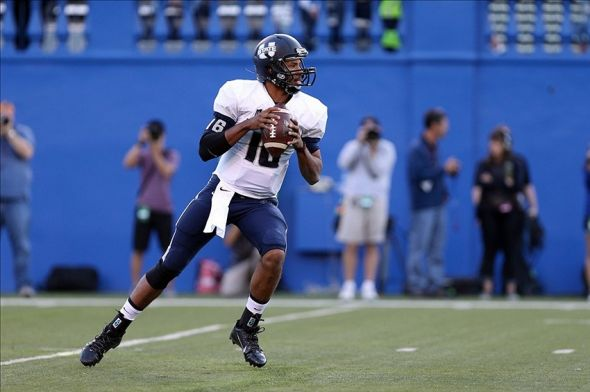 Sep 27, 2013; San Jose, CA, USA; Utah State Aggies quarterback Chuckie Keeton (16) looks for an open receiver against the San Jose State Spartans during the first quarter at Spartan Stadium. Mandatory Credit: Kelley L Cox-USA TODAY Sports