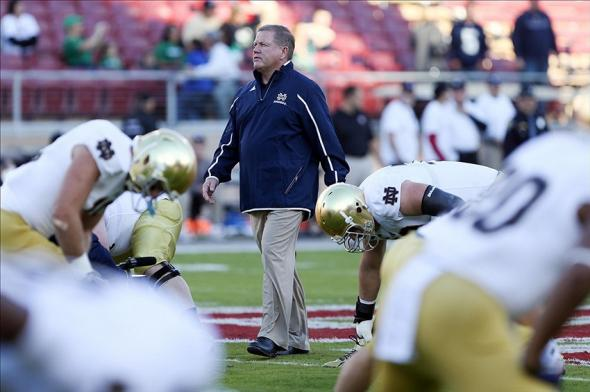 Nov 30, 2013; Stanford, CA, USA; Notre Dame Fighting Irish head coach Brian Kelly walks amongst players before the game against the Stanford Cardinal at Stanford Stadium. Mandatory Credit: Kelley L Cox-USA TODAY Sports