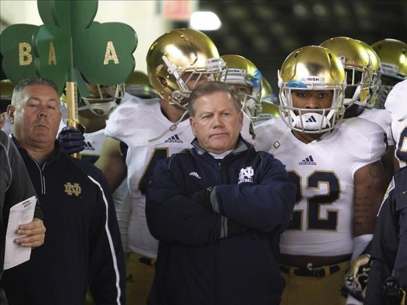 Nov 9, 2013; Pittsburgh, PA, USA; Notre Dame head coach Brian Kelly (center) waits to lead the Fighting Irish onto the field to play the Pittsburgh Panthers during the first quarter at Heinz Field. PITT won 28-21. Mandatory Credit: Charles LeClaire-USA TODAY Sports