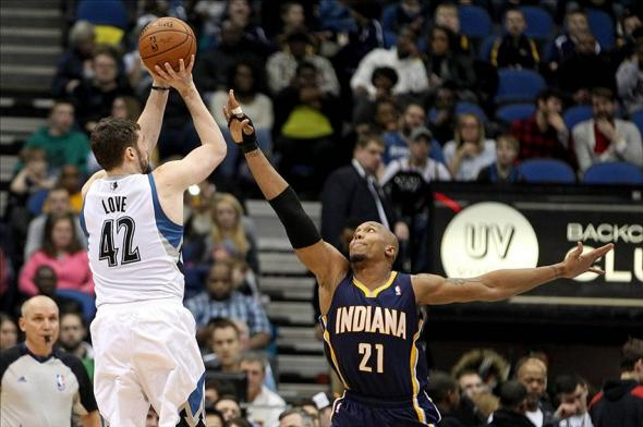 Feb 19, 2014; Minneapolis, MN, USA; Minnesota Timberwolves forward Kevin Love (42) shoots over Indiana Pacers forward David West (21) during the second quarter at Target Center. Mandatory Credit: Brace Hemmelgarn-USA TODAY Sports