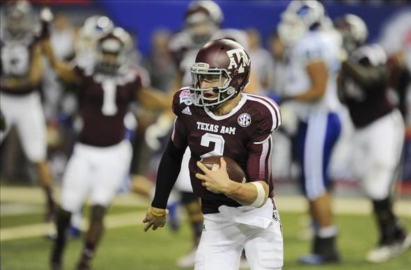 Dec 31, 2013; Atlanta, GA, USA; Texas A&M Aggies quarterback Johnny Manziel (2) carries the ball for a three yard touchdown against the Duke Blue Devils in the 2013 Chick-fil-a Bowl at the Georgia Dome. Mandatory Credit: Dale Zanine-USA TODAY Sports