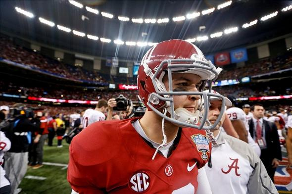 Jan 2, 2014; New Orleans, LA, USA; Alabama Crimson Tide quarterback AJ McCarron (10) walks off the field following a loss to the Oklahoma Sooners in a game at the Mercedes-Benz Superdome. Oklahoma defeated Alabama 45-31. Mandatory Credit: Derick E. Hingle-USA TODAY Sports