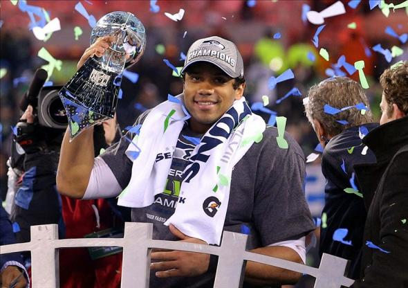 Feb 2, 2014; East Rutherford, NJ, USA; Seattle Seahawks quarterback Russell Wilson (3) celebrates with the Lombardi Trophy after beating the Denver Broncos 43-8 in Super Bowl XLVIII at MetLife Stadium. Mandatory Credit: Brad Penner-USA TODAY Sports
