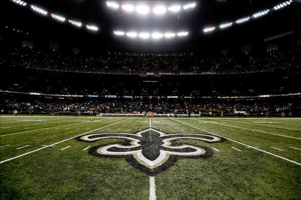 Nov 17, 2013; New Orleans, LA, USA; A detail of the New Orleans Saints fleur de lis logo at midfield after a win against the San Francisco 49ers in a game at Mercedes-Benz Superdome. The Saints defeated the 49ers 23-20. Mandatory Credit: Derick E. Hingle-USA TODAY Sports
