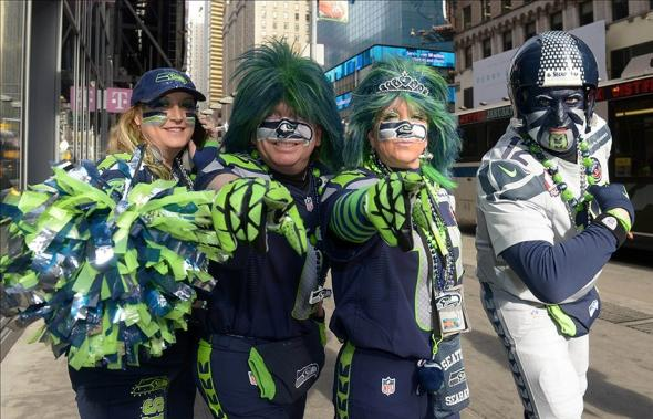 Feb 1, 2014; New York, NY, USA; Seattle Seahawks fans pose on Super Bowl Boulevard on Broadway in advance of Super Bowl XLVIII. From left: Laura Carter and Jeff Schumaier and Dede Schumaier and Brad Carter. Mandatory Credit: Kirby Lee-USA TODAY Sports