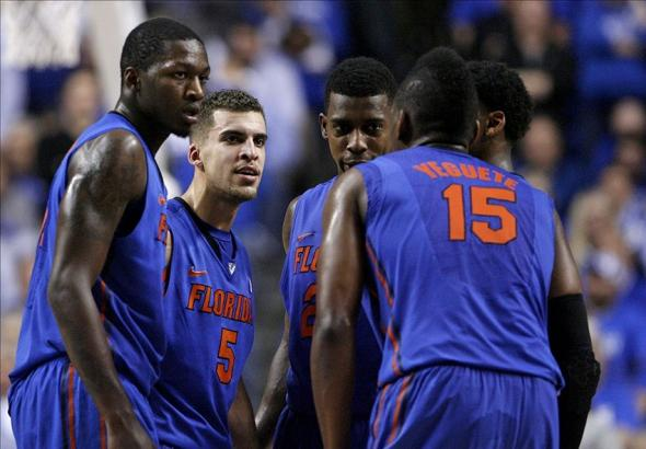 Feb 15, 2014; Lexington, KY, USA; Florida Gators guard Scottie Wilbekin (5) huddles with his teammates during the game against the Kentucky Wildcats at Rupp Arena. Florida defeated Kentucky 69-59. Mandatory Credit: Mark Zerof-USA TODAY Sports