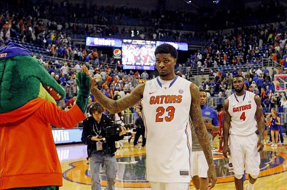 Feb 8, 2014; Gainesville, FL, USA; Florida Gators mascot, Albert, high fives forward Chris Walker (23) after they beat the against the Alabama Crimson Tide at Stephen C. O