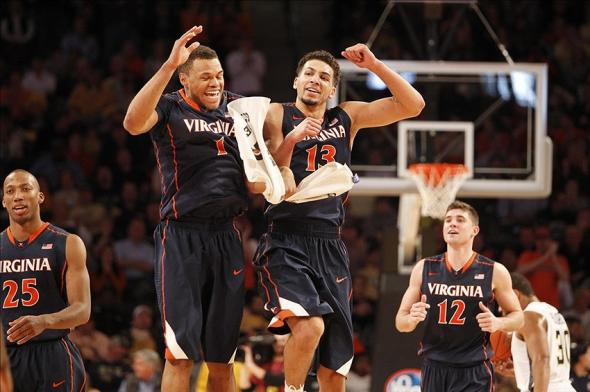 Feb 8, 2014; Atlanta, GA, USA; Virginia Cavaliers guard Justin Anderson (1) and forward Anthony Gill (13) show emotion during a timeout against the Georgia Tech Yellow Jackets in the second half at Hank McCamish Pavilion. Virginia defeated Georgia Tech 64-45. Mandatory Credit: Brett Davis-USA TODAY Sports