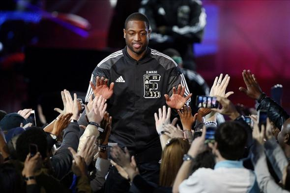 Feb 16, 2014; New Orleans, LA, USA; Eastern Conference guard Dwyane Wade (3) of the Miami Heat is introduced before the 2014 NBA All-Star Game at the Smoothie King Center. Mandatory Credit: Derick E. Hingle-USA TODAY Sports