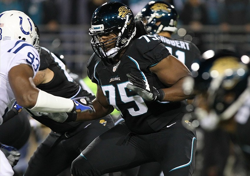 November 8, 2012; Jacksonville FL, USA; Jacksonville Jaguars tackle Eugene Monroe (75) blocks during the first quarter against the Indianapolis Colts at EverBank Field. Mandatory Credit: Kim Klement-USA TODAY Sports