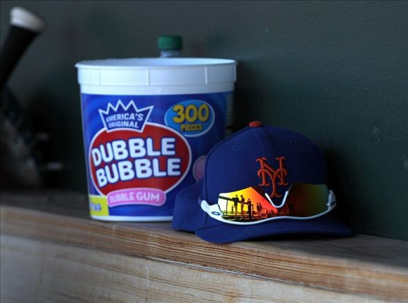 March 30, 2013; Sarasota, FL, USA; New York Mets hat and glasses lay with a tub of bubble gum in the dugout against the Baltimore Orioles at Ed Smith Stadium. Mandatory Credit: Kim Klement-USA TODAY Sports