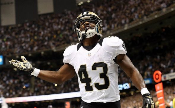 Sep 30, 2013; New Orleans, LA, USA; New Orleans Saints running back Darren Sproles (43) celebrates a touchdown against the Miami Dolphins in the second half at the Mercedes-Benz Superdome. New Orleans defeated Miami 38-17. Mandatory Credit: Crystal LoGiudice-USA TODAY Sports