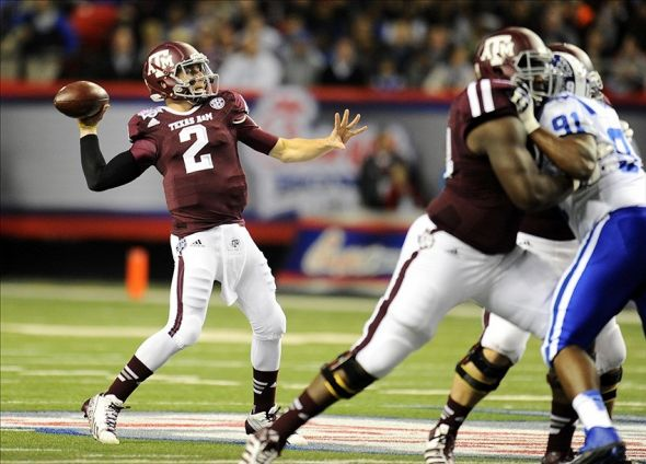 Dec 31, 2013; Atlanta, GA, USA; Texas A&M Aggies quarterback Johnny Manziel (2) throws the ball against the Duke Blue Devils during the first quarter in the 2013 Chick-fil-a Bowl at the Georgia Dome. Mandatory Credit: Dale Zanine-USA TODAY Sports