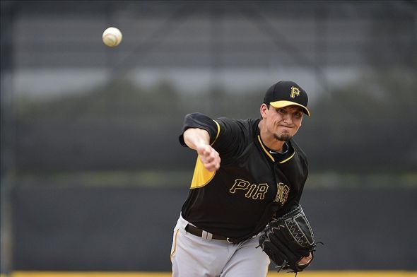 Mar 4, 2014; Lakeland, FL, USA; Pittsburgh Pirates starting pitcher Charlie Morton (50) throws a pitch during the first inning of a spring training game against the Detroit Tigers at Joker Marchant Stadium. Mandatory Credit: Tommy Gilligan-USA TODAY Sports