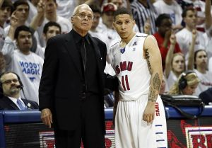 Mar 5, 2014; Dallas, TX, USA; Southern Methodist Mustangs head coach Larry Brown and guard Nic Moore (11) look on from the sidelines during the second half against the against the Louisville Cardinals at Moody Coliseum. Mandatory Credit: Jim Cowsert-USA TODAY Sports