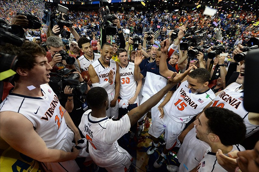 Virginia fan fakes his way onto court; gets free gear and ...