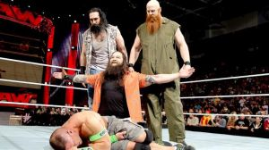 WWE's The Wyatt Family (Bray Wyatt in the middle) over John Cena's body. Photo credit: WWE.com