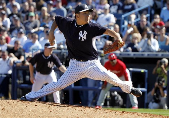 Mar 1, 2014; Tampa, FL, USA; New York Yankees starting pitcher Masahiro Tanaka (19) throws a pitch during the fifth inning against the Philadelphia Phillies at George M. Steinbrenner Field. Mandatory Credit: Kim Klement-USA TODAY Sports