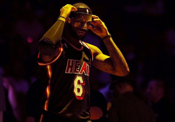Mar 1, 2014; Miami, FL, USA; Miami Heat small forward LeBron James (6) adjusts his mask before a game against the Orlando Magic at American Airlines Arena. Mandatory Credit: Robert Mayer-USA TODAY Sports