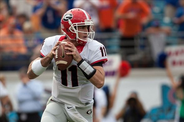 Nov 2, 2013; Jacksonville, FL, USA; Georgia Bulldogs quarterback Aaron Murray (11) sets to throw during the first half of the game against the Florida Gators at EverBank Field. Mandatory Credit: Rob Foldy-USA TODAY Sports