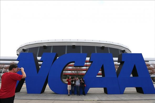 Apr 8, 2013; Atlanta, GA, USA; Fans take photos in front of a giant NCAA logo before the championship game in the 2013 NCAA mens Final Four at the Georgia Dome. Mandatory Credit: Daniel Shirey-USA TODAY Sports