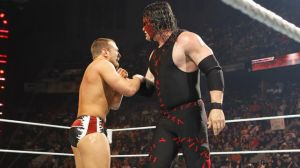 Team Hell No: Kane grabs Daniel Bryan by the throat for an attempted Choke Slam.