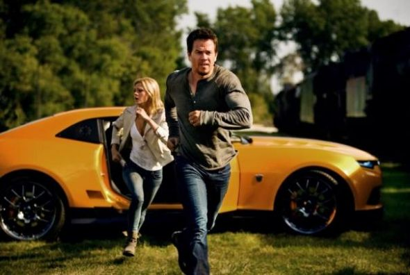 "Mark Wahlberg and Nicola Peltz as Cade and Tessa Yeager in ""Transformers: Age of Extinction."" Photo Credit: Paramount Pictures"