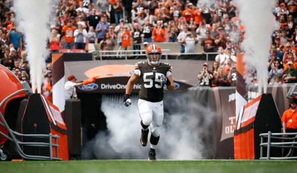 Sep 29, 2013; Cleveland, OH, USA; Cleveland Browns center Alex Mack (55) runs onto the field before the game against the Cincinnati Bengals at FirstEnergy Stadium. Mandatory Credit: Raj Mehta-USA TODAY Sports