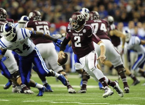 Dec 31, 2013; Atlanta, GA, USA; Texas A&M Aggies quarterback Johnny Manziel (2) runs the ball past Duke Blue Devils defense during the third quarter in the 2013 Chick-fil-A Bowl at the Georgia Dome. Mandatory Credit: Kevin Liles-USA TODAY Sports