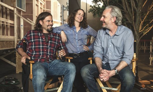 "Screewriter Peter Craig, Producer Nina Jacobson, and Director Francis Lawrence on the set of ""The Hunger Games: Mockingjay Part 1"" Photo Credit: Lionsgate"