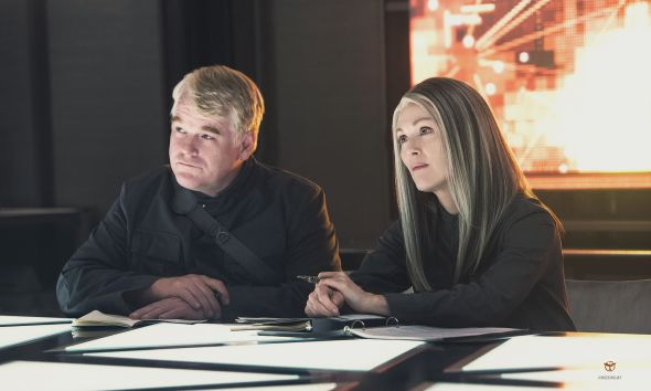 "Phillip Seymour Hoffman and Julianne Moore as Plutarch Heavensbee and President Coin in ""The Hunger Games: Mockingjay Part 1."" Photo Credit: Lionsgate"