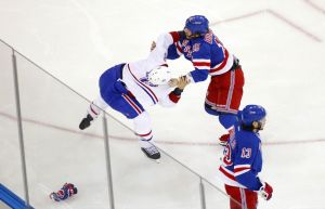May 22, 2014; New York, NY, USA; Montreal Canadiens right wing Brandon Prust (8) fights with New York Rangers right wing Derek Dorsett (15) as left wing Daniel Carcillo (13) skates away during the first period in game three of the Eastern Conference Final of the 2014 Stanley Cup Playoffs at Madison Square Garden. Mandatory Credit: Andy Marlin-USA TODAY Sports