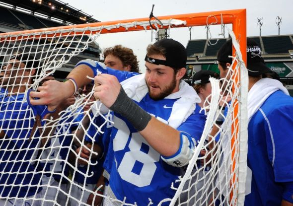 May 27, 2013; Philadelphia, PA, USA; Duke Blue Devils defenseman Jimmy O'Neill (28) cuts a piece of the net following his teams 16-10 victory over the Syracuse Orange in the 2013 NCAA Division I Men's Lacrosse Championship Game at Lincoln Financial Field. Mandatory Credit: Rich Barnes-USA TODAY Sports