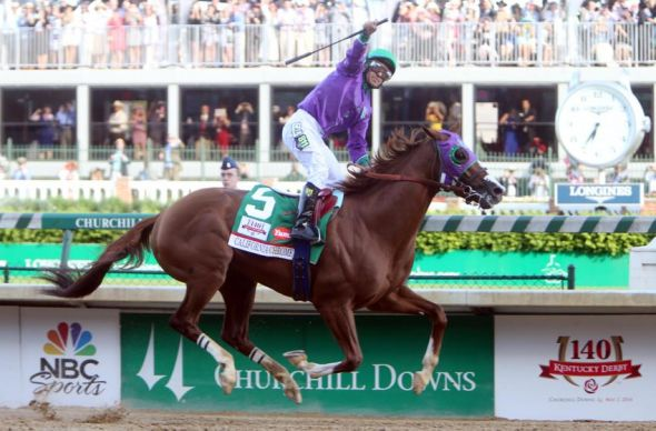 May 3, 2014; Louisville, KY, USA; Victor Espinoza aboard California Chrome (5) celebrates as they cross the finish line to win the 2014 Kentucky Derby at Churchill Downs. Mandatory Credit: Jerry Lai-USA TODAY Sports
