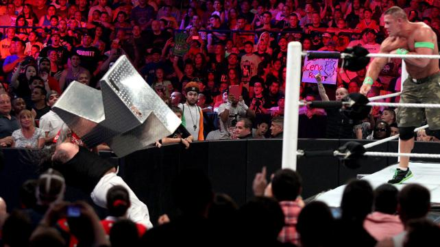 Arguably the spot of the night: John Cena throws the steel steps at Bray Wyatt. Photo credit: WWE.com