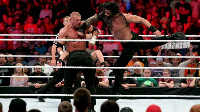Reigns Superman Punch on HHH
