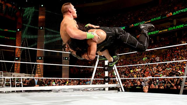I know you're angry about Cena winning, so here's a photo of him getting speared to oblivion (temporarily). Photo credit: WWE.com