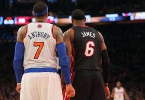 Feb 1, 2014; New York, NY, USA; New York Knicks small forward Carmelo Anthony (7) and Miami Heat small forward LeBron James (6) stand side by side during the fourth quarter of a game at Madison Square Garden. The Heat defeated the Knicks 106-91. Mandatory Credit: Brad Penner-USA TODAY Sports