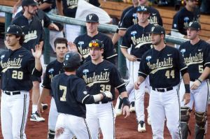 Jun 25, 2014; Omaha, NE, USA; Teammates congratulate Vanderbilt Commodores infielder Dansby Swanson (7) after scoring the first run of the game in the first inning during game three of the College World Series Finals against the Virginia Cavaliers at TD Ameritrade Park Omaha. Mandatory Credit: Steven Branscombe-USA TODAY Sports