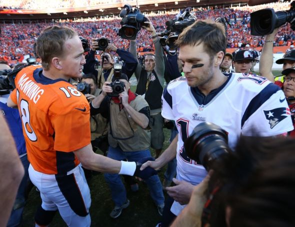 Jan 19, 2014; Denver, CO, USA; Denver Broncos quarterback Peyton Manning (18) meets with New England Patriots quarterback Tom Brady (12) after the 2013 AFC Championship game at Sports Authority Field at Mile High. Mandatory Credit: Matthew Emmons-USA TODAY Sports