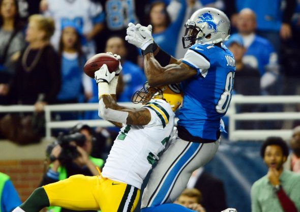 Nov 28, 2013; Detroit, MI, USA; Green Bay Packers cornerback Sam Shields (37) intercepts a pass intended for Detroit Lions wide receiver Calvin Johnson (81) during the third quarter of a NFL football game on Thanksgiving at Ford Field. Mandatory Credit: Andrew Weber-USA TODAY Sports