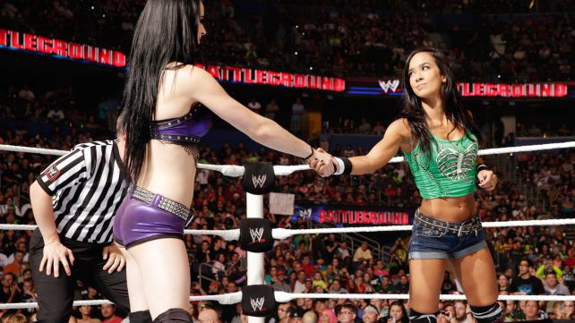 """""""Frenemies"""" before the match and still after. Paige and A.J.'s story went nowhere at Battleground. (Photo credit: WWE.com)"""