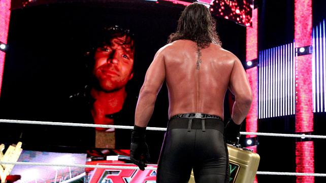 Dean Ambrose appears on the TitanTron to let Seth Rollins know his dreams of cashing-in his title shot will be a recurring nightmare. Photo credit: WWE.com