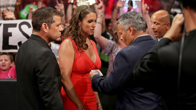 """The """"cops"""" reading Stephanie's rights on a Miranda card was a nice, simple touch of hilarity during this crazy segment. (Photo Credit: WWE.com)"""