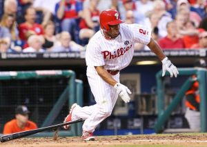Jun 26, 2014; Philadelphia, PA, USA; Philadelphia Phillies center fielder Ben Revere (2) singles to center during the fifth inning of a game against the Miami Marlins at Citizens Bank Park. Mandatory Credit: Bill Streicher-USA TODAY Sports